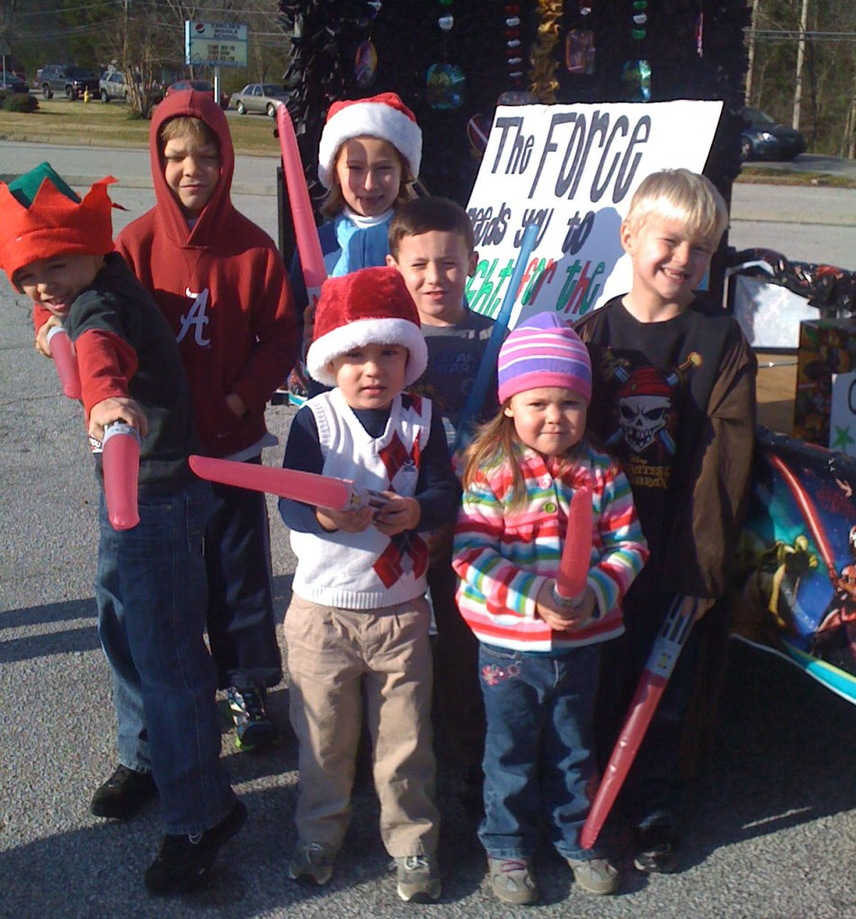 Kaeden with his friends and their float.